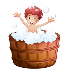 A young boy playing at the bathtub vector image