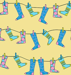 Seamless Pattern Socks Drying on the Clothesline vector