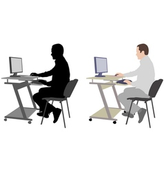 man working on his desktop computer vector image
