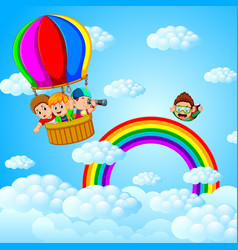 happy kids flying in a hot air baloon and skydiver vector image