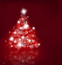 Lighted up Christmas tree with many lensflares on vector