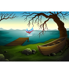 A boat under the tree near the sea with a big fish vector image