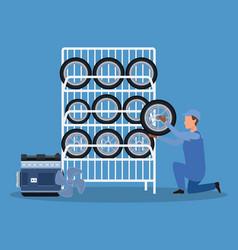 Cartoon mechanic holding a car tire and car tires vector