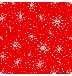 Seamless pattern of falling snowflakes vector