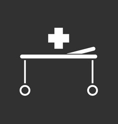 White icon on black background medical stretcher vector