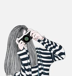 the girl holding a stylish camera vector image