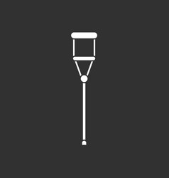White icon on black background medical crutch vector