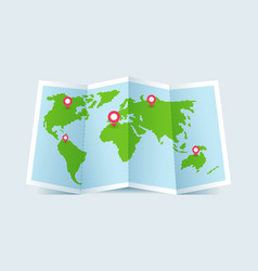 Green folded paper world map with pins vector