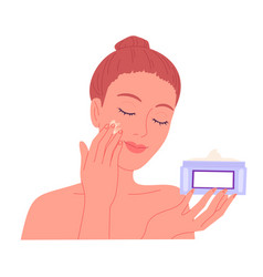 Young woman applying cream to her face vector