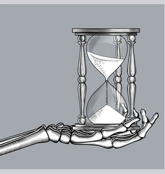 Skeleton hand with a retro hourglass vector