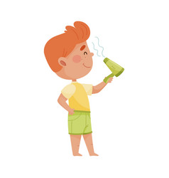 Smiling little boy drying his hair with blow dryer vector