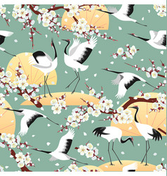 Seamless pattern with japanese cranes and blossoms vector