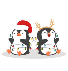 cute little penguins wishing a merry christmas vector image