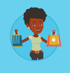 happy woman holding shopping bags vector image