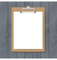 Clipboard with white paper on grey wood background vector image