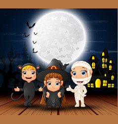 Happy halloween kids with scary house and full moo vector