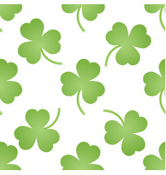 pattern with green clovers vector image