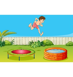 A boy on a trampoline vector