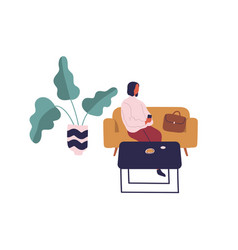 woman sitting on couch at table with food use vector image