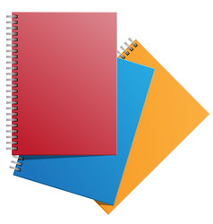 notebooks red yellow blue on white vector image vector image