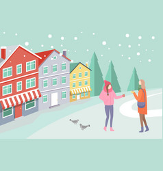 women on snowing street near colorful house vector image