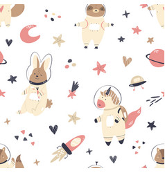 Seamless pattern with animals and space elements vector