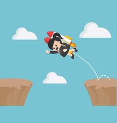 businesswoman jumps over rocky cliffs vector image