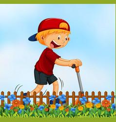 A boy playing kick schooter in garden vector