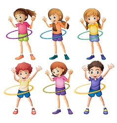 Kids playing hulahoop vector image