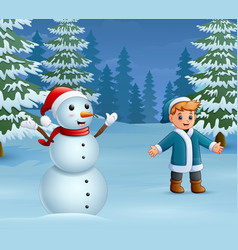 happy boy playing with a snowman in winter vector image