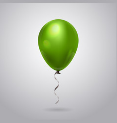green helium balloon with ribbon isolated on grey vector image