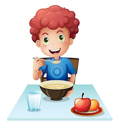 A curly boy eating his breakfast vector image