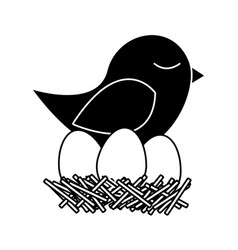 Black silhouette of bird in nest with eggs vector