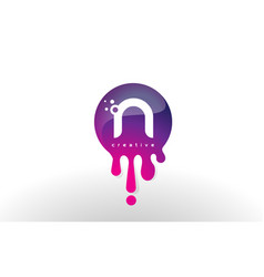 N letter splash logo purple dots and bubbles vector