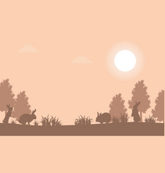 silhouette of bunny at sunset landscape vector image vector image