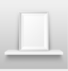 Realistic wall shelf with empty picture frame vector
