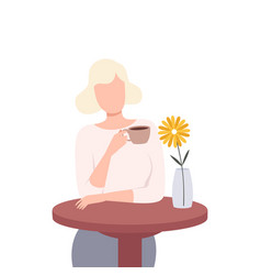 beautiful blonde girl sitting at table and vector image