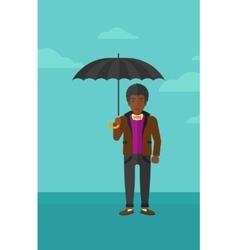 Businessman standing with umbrella vector
