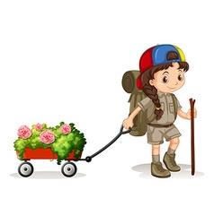 Little girl pulling wagon of flowers vector