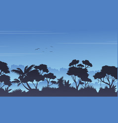 Silhouette of tree on the rain forest scenery vector