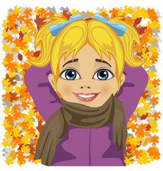 Little girl lying on autumn leaves vector