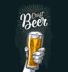 male hand holding a glass craft beer lettering vector image vector image