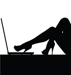 woman legs on laptop silhouette vector image