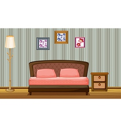 A bed and a lamp vector image