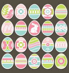 set of color easter eggs over brown wooden vector image