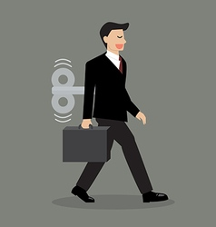 Businessman with wind up key in his back vector