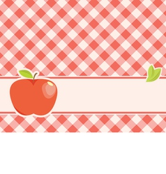 ripe red apple on a plaid background vector image