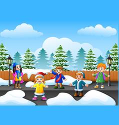 Cartoon kids playing in the snowing garden vector