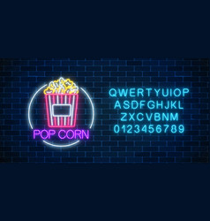 Neon glowing sign of pop corn in circle frame vector