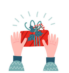 two hands holding a gift box decorated plants vector image